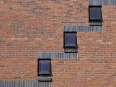 architectural background with a modern brick wall and windows and lots of copyspace poster