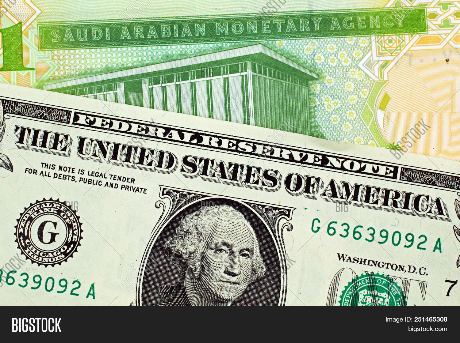 A Close Image Of Green One Saudi Riyal Note With An American Dollar Bill