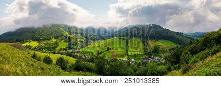 Panorama Of A Rural Area In Mountains. Gorgeous Forenoon With Beautiful Clouds On The Sky. Agricultu