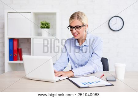 Young Business Woman Using Computer In Office