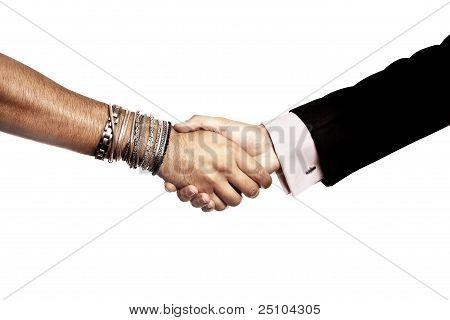 Handshake between alternative man and businessman