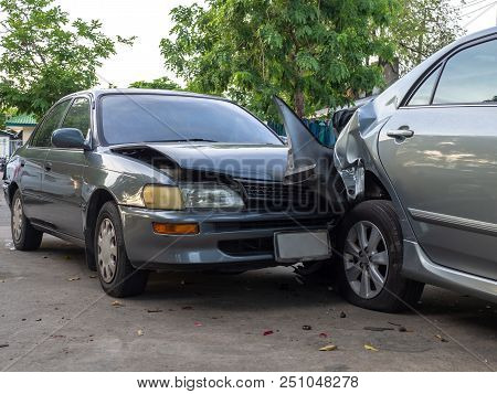 Car Crash Accident On Street With Wreck And Damaged Automobiles. Accident Caused By Negligence And L