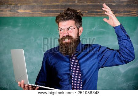 Can Not Get Used To Modern Technology. Teacher Bearded Man With Modern Laptop Chalkboard Background.