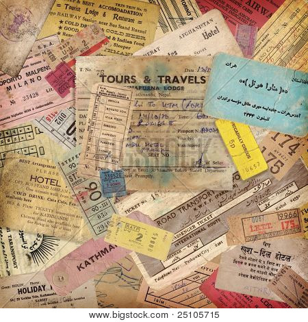 vintage travel background made of lots of old tickets, boarding passes, hotel reception cards and other documents