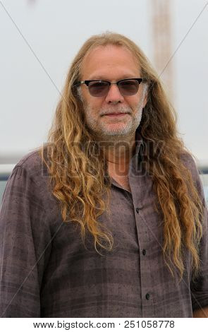 Greg Nicotero arrives at a special AMC