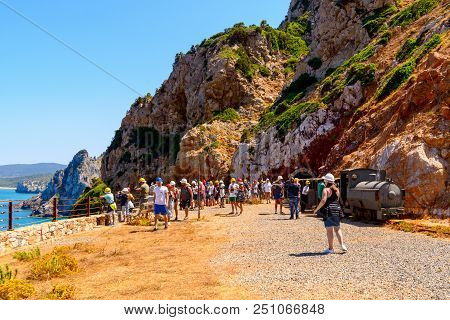 Buggerru, Sardinia, Italy - July 27, 2018: Every Year, Thousands Of Tourists From All Over The Count