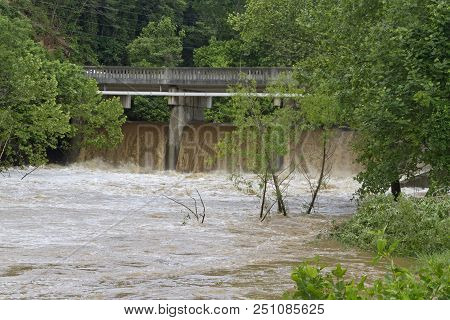 Asheville, North Carolina, Usa - May 30, 2018: A Dam Releasing The Wildly Turbulent, Muddy Water Of