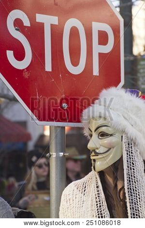 Asheville, North Carolina, Usa - February 7, 2016: Young Woman Wearing A Guy Fawkes Mask Stands By A
