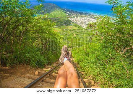 Legs Of Traveler Sitting At The Beginning Of 1048 Steps Of Popular Hawaiian Hiking, Koko Head Stairs