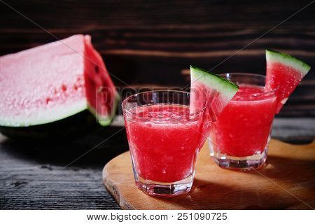 Watermelon Cocktail On A Wooden Table. Selective Focus