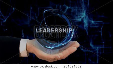 Painted Hand Shows Concept Hologram Leadership On His Hand. Drawn Man In Business Suit With Future T
