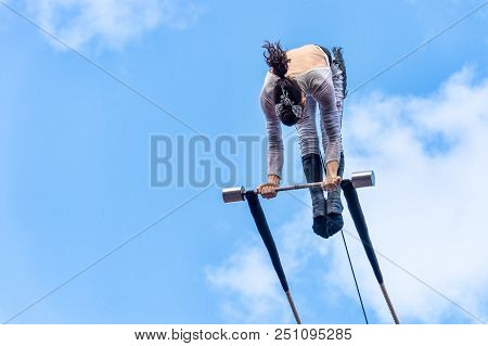 Montreal, Canada - 14 July 2018: Trapeze Artist Performing During Montreal Completement Cirque Festi