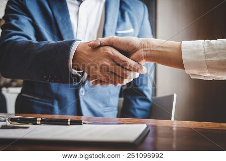 poster of Real estate agent and customers shaking hands together celebrating finished contract after about home insurance and investment loan, handshake and successful deal.