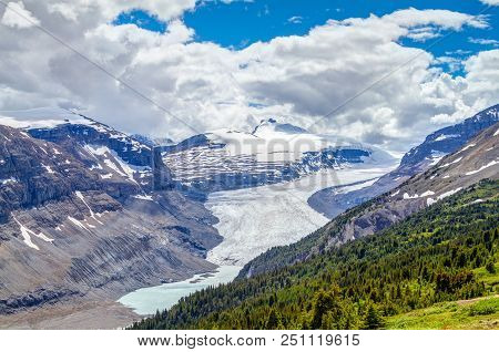 Sweeping Vista Of Saskatchewan Glacier Flowing From The Columbia Icefields As Seen From The Crest Of
