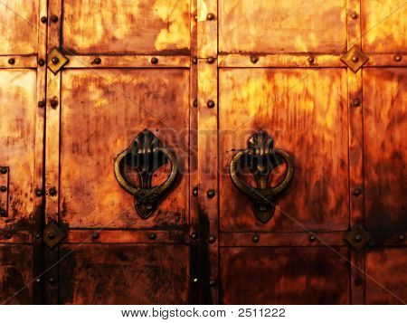 medieval coppery gates with wrought knockers oo poster
