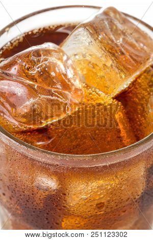 Close-up View On Glass With Cola And Ice On White Background