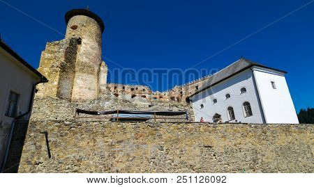 Stara Lubovna, Slovakia - Aug 28, 2016: Tall Tower And Main Building Of A Castle. Stone Wall In The