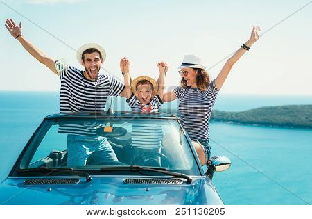 Happy Family Travel By Car To The Sea. People Having Fun In Cabriolet. Summer Vacation Concept