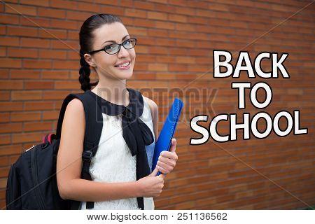 Back To School - Beautiful Smiling Teenage Girl With Backpack And Folder