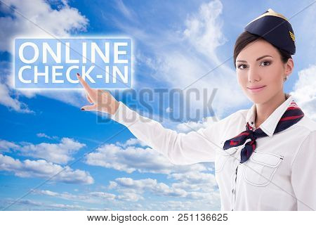 Online Check-in - Stewardess Pointing At Check-in Button Over Blue Sky Background