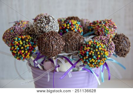 colored sweet cake pops candy. Candy bar and popcakes catering concept for birthday, wedding and other holiday celebration poster