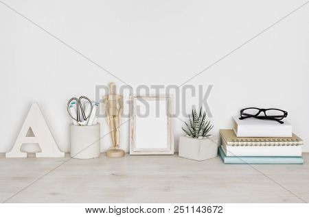 Desktop With Picture Frame, Books, Flower Pot And Educational Supplies
