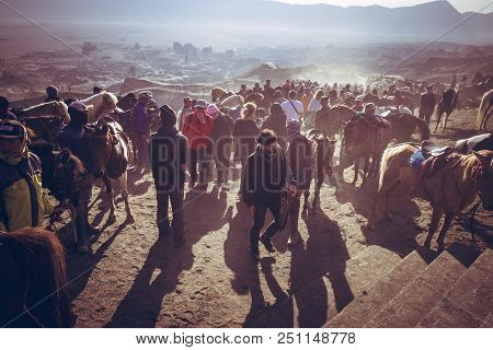 East Java, Indonesia - July 18, 2018: Tourist Ride A Horse And Walking On The Volcano Desert At Moun