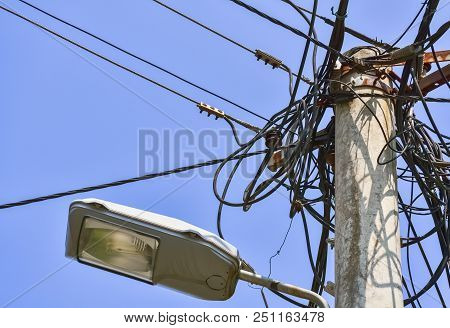 Dangerous Mess Of Electric Cables On The Street Lamppost