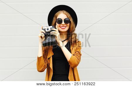 Happy Cool Young Woman Model With Retro Film Camera Wearing A Elegant Hat, Brown Jacket Outdoors Ove