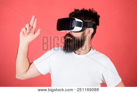 Best shooters for VR. First person shooter shows how addictive VR could be. Man hand gesture as gun play shooter game in VR glasses. Man bearded hipster with virtual reality headset on red background. poster