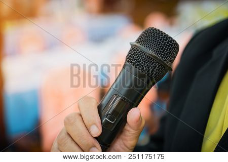 Seminar Conference Concept : Hands Businesspeople Holding Microphones For Speech Or Speaking  In Sem