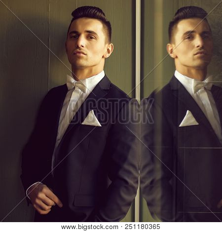 Man In Suit With White Bow Tie Handkerchief Young Elegant Stylish Turns Sideway With Head Up And Ref