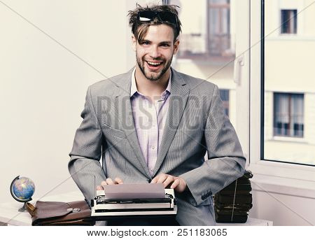 Writer Or Businessman Wearing Grey Suit. Young Author Or Editor Writes Story On Old Typewriter On Wi