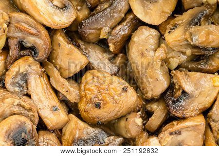 Overhead Closeup View Of Savory Sliced White Mushrooms Cooked To A Golden Color