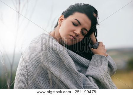 Portrait Of Attractive Brunette Caucasian Young Woman Traveler With Windy Hair, Dreaming Outside In