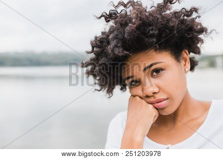 Closeup Portrait Of Pensive Beautiful African American Young Woman Posing Outdoors, Have Sad Face. B