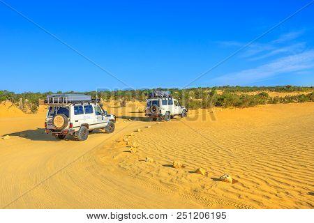 Cervantes, Australia - Dec 22, 2017: Toyota Land Cruiser Four-wheel-drive Jeeps Running On The Pinna