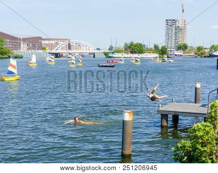 Amsterdam, The Netherlands - July 27 2018: People Jumping From Into The Ij Haven During The European