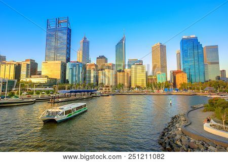 Perth, Australia - Jan 6, 2018: Turistic Ferry In Elizabeth Quay Marina At Sunset With Skyscrapers O