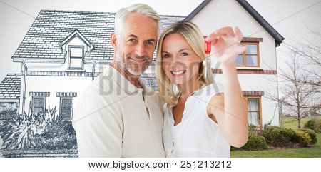 Happy couple showing their new house key against home sketch
