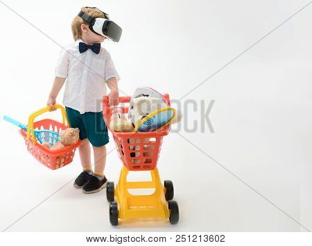 Shopping, Modern Technology Concept - Little Boy With Shopping Cart&basket In Virtual Reality Glasse