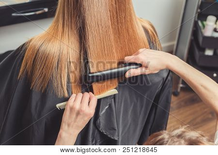 Hairdresser Making A Hairstyle For Client