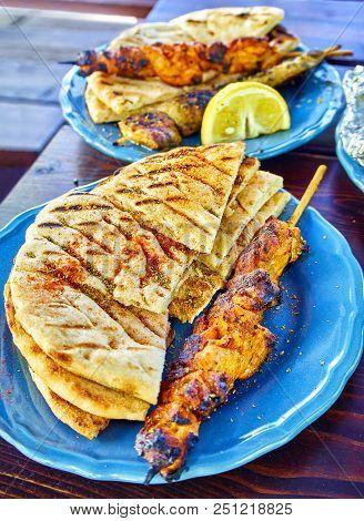 Spiced Chicken Souvlakis With Seasoned Pita Bread. Typical Greek Skewer.