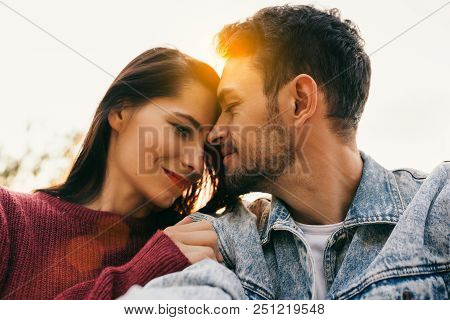 Happy Couple In Love Enjoying Sunshine Embracing Each Other Looking With Love Having Eyes Full Of Ha
