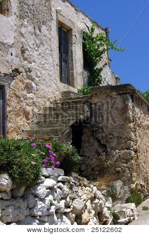 Ruins of mediterranean house with outgrowing vegetiation