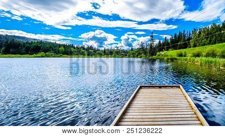 The Fishing Dock On Little Heffley Lake, A Small Fishing Lake At The Heffley-sun Peaks Road In The S