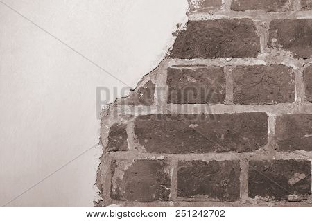 Part of the red brick wall of an old house with a figured pattern of white putty. Black and white background, contrasting texture. A place for a label. poster