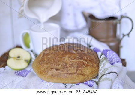 Homebaked Bread. Bakery Products. Milk In A Pitcher. Vintage Napkins And Tablecloth. Cut Apple