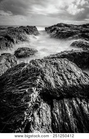 Foggy Sea And Rocks In Black And White