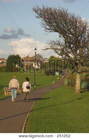Couple Walking On Coastal Path